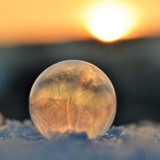 Sunlight shining through ball of ice